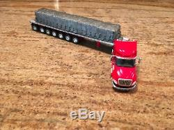 1/64 DCP Red InternationalSleeper Cab with Heavy Duty 7 Axle flatbed tlr. Withload